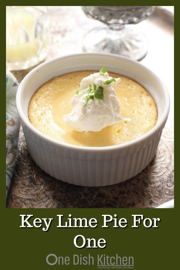 All the flavors you love in a Key Lime Pie can be found in this Key Lime Pie recipe for one! Smooth and creamy with the perfect balance of tart and sweet. Baked in a ramekin or small baking dish, this classic pie comes complete with a buttery graham cracker crust. So easy to make! | One Dish Kitchen | #keylime #singleserving #pierecipe #lime #pie