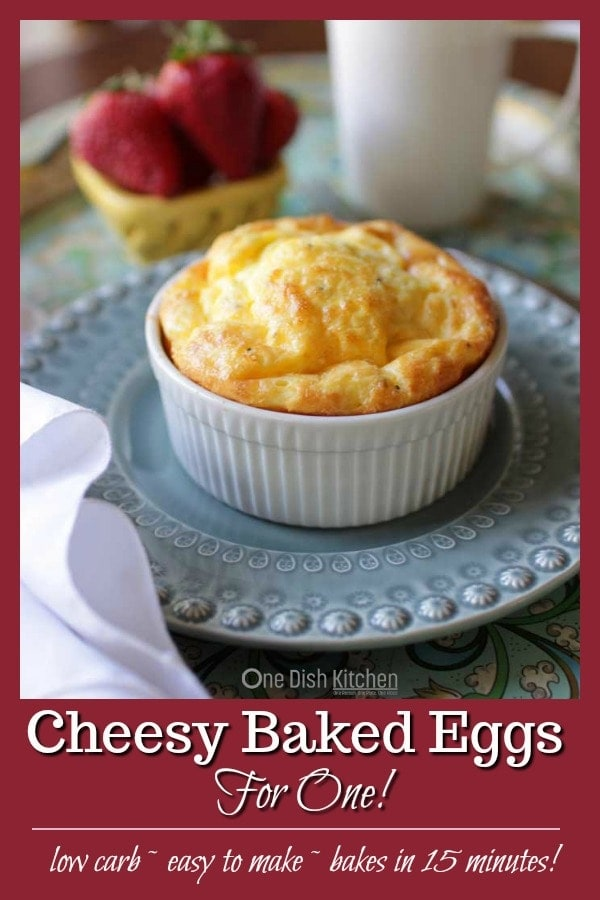 Cheesy Baked Eggs For One, two eggs mixed with cream or milk, cheese and seasonings baked in a ramekin and ready in 15 minutes. Light, easy to make, hearty and so tasty. A wonderful single serving breakfast recipe.   One Dish Kitchen   #singleserving #breakfast #ramekin #cookingforone #recipeforone #lowcarb