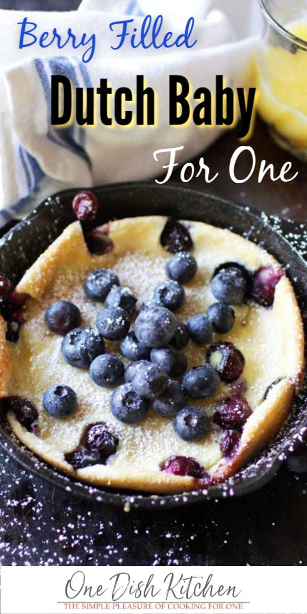 This berry filled Dutch Baby is perfect for breakfast or dessert. Also called a Puffed Pancake, this wonderful treat is a cross between a pancake and a crepe. It's baked in a mini skillet and is the perfect amount for anyone cooking for one. | One Dish Kitchen